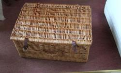 Empty wicker basket. Measures 22ins x 15ins.