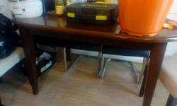 Table is extendable 2 wooden chair and 4 new-modern
