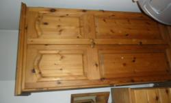 This is a solid wooden wardrobe. It is approximately
