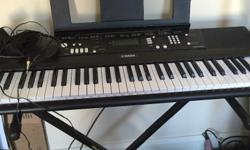 Yamaha organ ez 220 in very good condition with stand