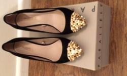 Zara women back shoes with golden and diamond studs.
